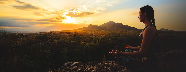girl meditating on mountain