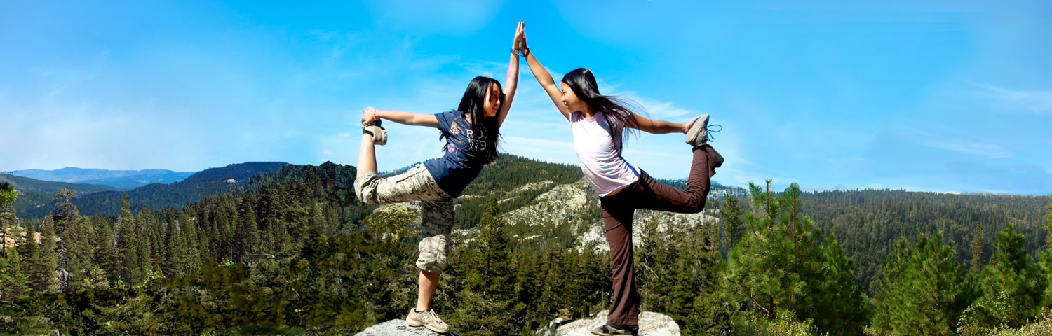 students doing yoga in mountains