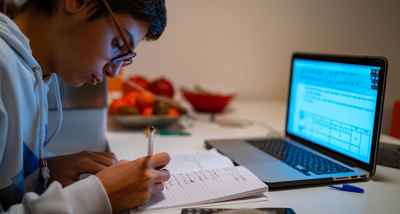 high school boy working on homework